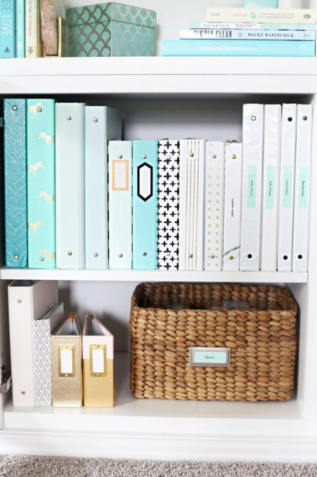This extremely organized home office is so functional and beautiful at the same time! It gives me so many great ideas for my own home office organization! | home office, craft room, woman cave, home office decor, feminine decor, allover stencil, stenciled wall, IKEA BESTA system, IKEA PAX system, organizing, etagere, pillow organization, organized books, organized binders, organized office supplies, organized craft supplies, IKEA hack, office nook, home office storage, storage basket with adhesive bookplate label, organized 3 ring binders