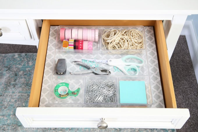 This extremely organized home office is so functional and beautiful at the same time! It gives me so many great ideas for my own home office organization! | home office, craft room, woman cave, home office decor, feminine decor, allover stencil, stenciled wall, IKEA BESTA system, IKEA PAX system, organizing, etagere, pillow organization, organized books, organized binders, organized office supplies, organized craft supplies, IKEA hack, office nook, home office storage, reading corner, aqua office, white writing desk, desk organization