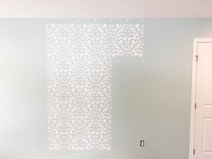 This detailed post is so helpful in teaching how to stencil a wall, allover stenciling! The outcome is absolutely gorgeous! | stenciled wall, stenciling, allover stencil, damask stencil, base color, Sherwin Williams Rainwashed, stenciling in progress