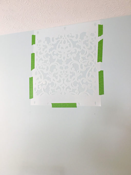 This detailed post is so helpful in teaching how to stencil a wall, allover stenciling! The outcome is absolutely gorgeous! | stenciled wall, stenciling, allover stencil, damask stencil, base color, Sherwin Williams Rainwashed, where to place the first stencil on the wall