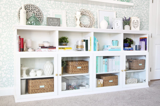 I love this IKEA BESTA hack to make a beautiful storage unit for a home office! And she tells you exactly how to do it too! | IKEA BESTA, IKEA hack, BESTA system, home office, DIY, trim work, office storage, office organization, organized office, shelf styling, bookshelf styling, styled shelves, functional and beautiful, attaching trim pieces to IKEA BESTA, crown molding, top trim pieces, styled bookcase from side view