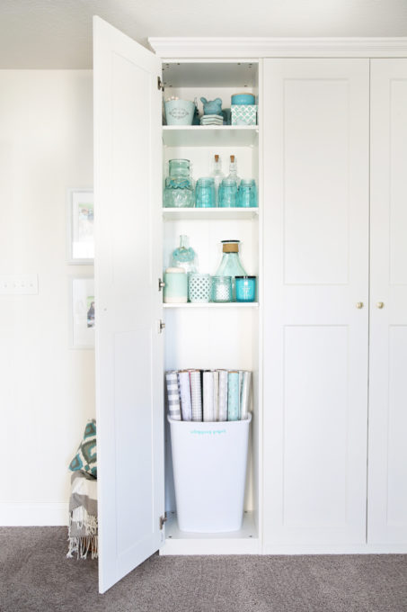This super helpful post talks about IKEA's 3 best storage systems-- ALGOT, BESTA, and PAX-- and gives great ideas for using them in your home! | IKEA BESTA storage system, modular storage system, IKEA ALGOT closet system, custom closet system, IKEA PAX wardrobe system, DIY wardrobe, IKEA hack, how to plan for and install IKEA storage systems, built in storage unit for home office made with IKEA PAX wardrobe system and custom trim work, GRIMO doors, aqua knick knack storage