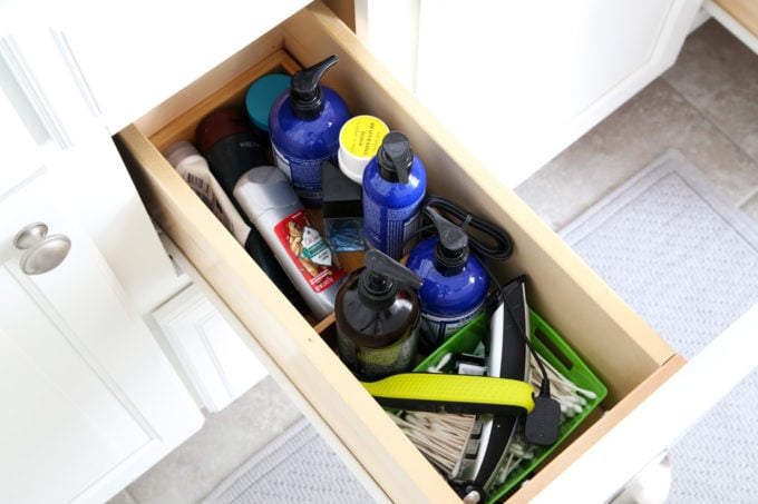 I'm sharing all of my favorite master bathroom organization ideas and some easy updates that we've done to take our master bathroom from cluttered and boring to organized and beautiful! | bathroom organization, organized bathroom vanity, how to organize a bathroom, how to organize deep vanity drawers, organized hair supplies, shaving tools organization, before photo of cluttered vanity drawer
