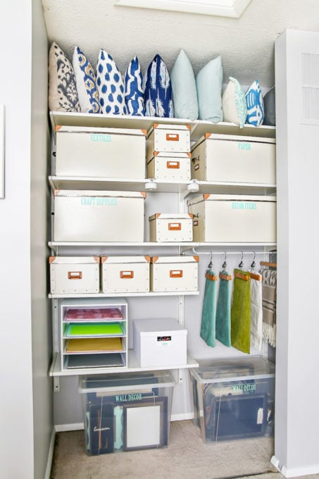 This super helpful post talks about IKEA's 3 best storage systems-- ALGOT, BESTA, and PAX-- and gives great ideas for using them in your home! | IKEA BESTA storage system, modular storage system, IKEA ALGOT closet system, custom closet system, IKEA PAX wardrobe system, DIY wardrobe, IKEA hack, how to plan for and install IKEA storage systems, organized home office closet and craft room closet with IKEA ALGOT closet system
