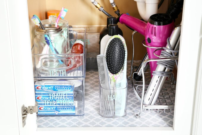 I'm sharing all of my favorite master bathroom organization ideas and some easy updates that we've done to take our master bathroom from cluttered and boring to organized and beautiful! | bathroom organization, organized bathroom vanity, how to organize a bathroom, how to organize deep vanity drawers, organized hair supplies, shaving tools organization, organized master bathroom cabinet