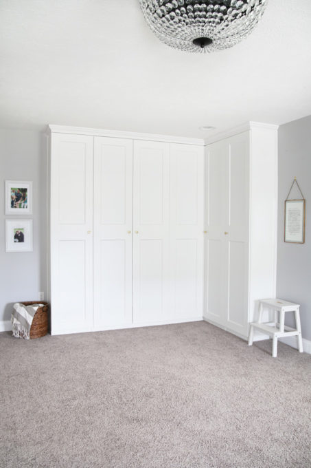 This super helpful post talks about IKEA's 3 best storage systems-- ALGOT, BESTA, and PAX-- and gives great ideas for using them in your home! | IKEA BESTA storage system, modular storage system, IKEA ALGOT closet system, custom closet system, IKEA PAX wardrobe system, DIY wardrobe, IKEA hack, how to plan for and install IKEA storage systems, built in storage unit for home office made with IKEA PAX wardrobe system and custom trim work, GRIMO doors