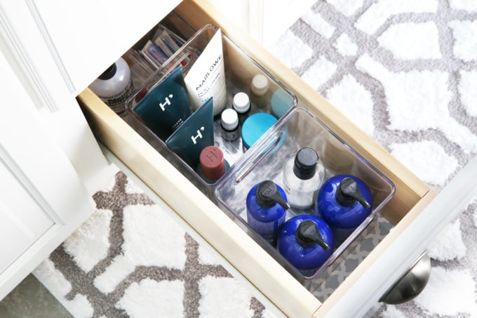 I'm sharing all of my favorite master bathroom organization ideas and some easy updates that we've done to take our master bathroom from cluttered and boring to organized and beautiful! | bathroom organization, organized bathroom vanity, how to organize a bathroom, how to organize deep vanity drawers, organized hair supplies, shaving tools organization, lotions and aftershave in bathroom vanity drawer