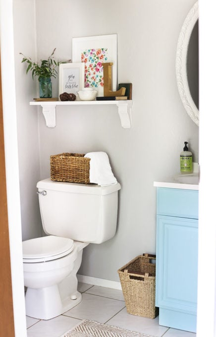 This post shares simple but brilliant ideas for updating your builder grade master bathroom in a weekend or less! | bathroom upgrades, easy bathroom DIY projects, how to decorate a builder grade bathroom, easy bathroom hacks, updating a bathroom on a budget, bathroom DIY shelf with corbels
