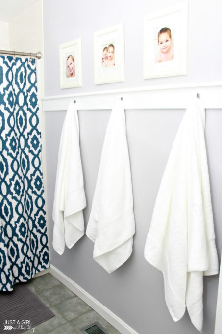 This post shares simple but brilliant ideas for updating your builder grade master bathroom in a weekend or less! | bathroom upgrades, easy bathroom DIY projects, how to decorate a builder grade bathroom, easy bathroom hacks, updating a bathroom on a budget, board and towel hooks