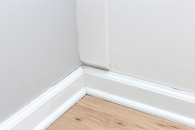 Angled Cut at the Bottom of a Board and Batten Vertical Against a Baseboard