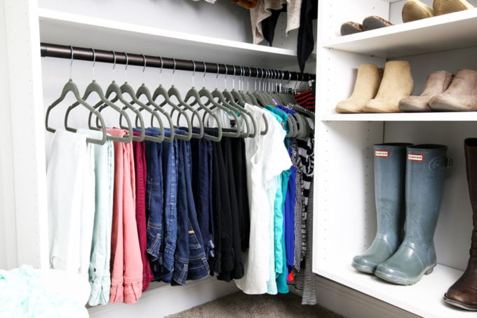 Hanging Clothes with Matching Hangers in an Organized Closet