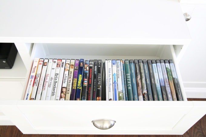 Organized DVDs in Clear Acrylic Bins in the Drawer of an Entertainment Center