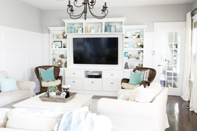 White Entertainment Center Made with IKEA BESTA Pieces in a Neutral Living Room with Aqua Accents