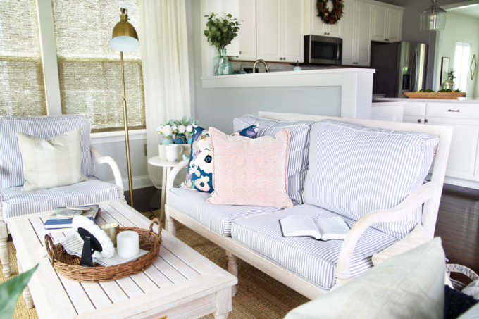 Sunroom with Whitewashed Wood Furniture and Ticking Stripe Cushions