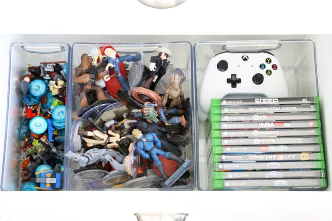 Organized LEGO, Disney Infinity Characters, and Video Games in Plastic Bins