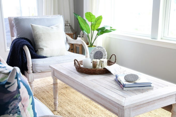 Whitewashed Wooden Coffee Table in Summer Sunroom