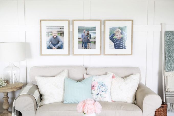 Family Photos Hung Above the Couch on Board and Batten, Summer Home Tour