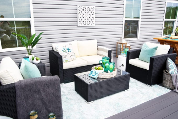 Outdoor Conversation Set with Teal Decor on an AZEK Deck