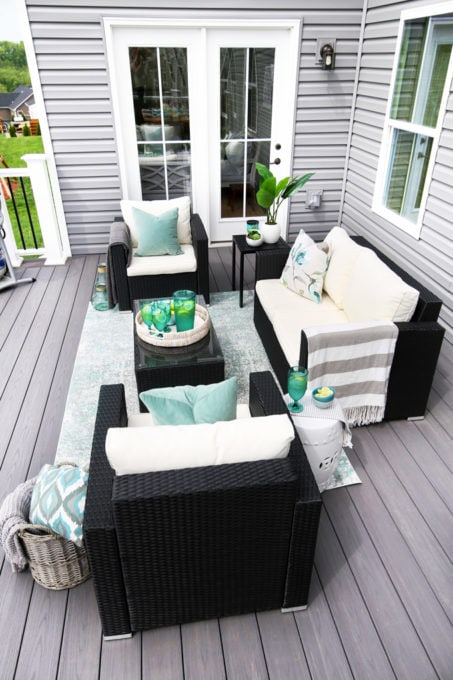 Summer Deck Decorating Ideas with a Seating Area with Teal Accents