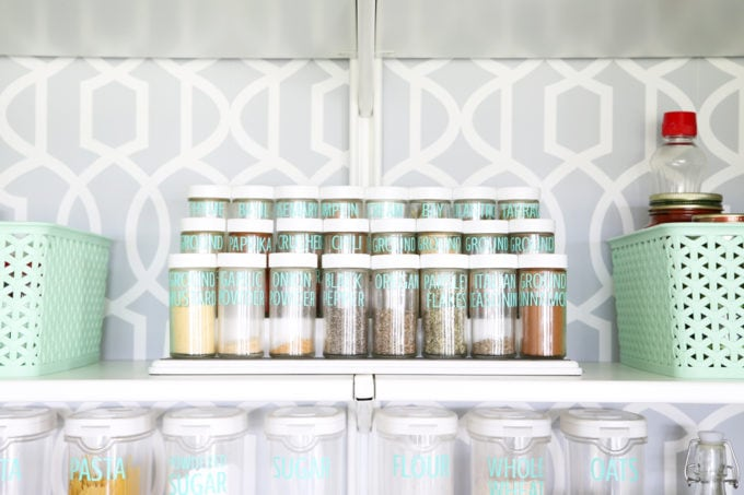 Spices in the Pantry on a Riser, Labeled with a Silhouette Cameo + Adhesive Vinyl