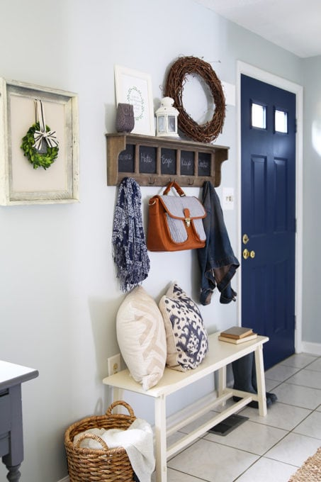 Small Entryway in a Townhouse with a Bench and Hooks for Coats