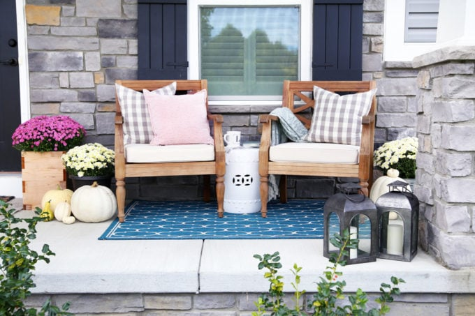 Wooden Chairs on a Stone Front Porch with Fall Decor