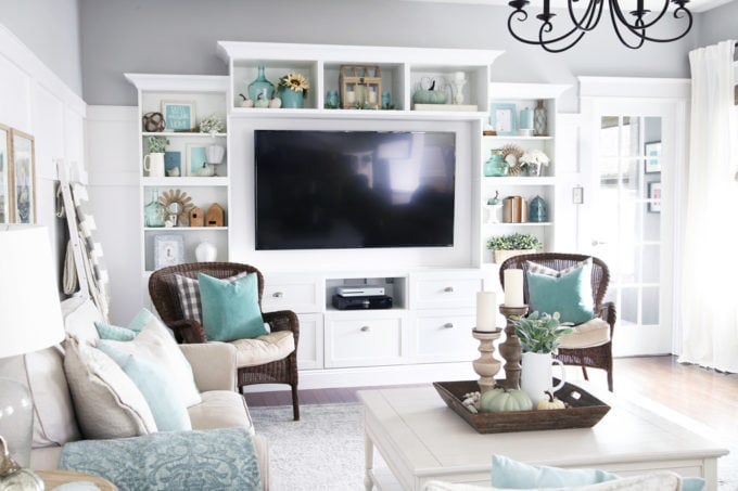 Aqua and White Fall Shelf Decor on an IKEA BESTA Entertainment Unit