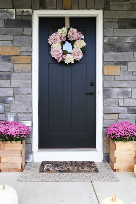 Black Craftsman Front Door with DIY Faux Hydrangea Wreath and Pink Mums in Planters