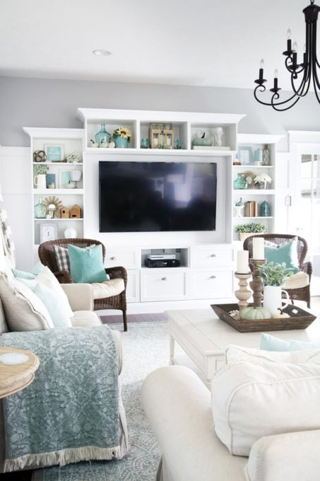 Gray, White, and Aqua Living Room with Styled Shelves for Fall