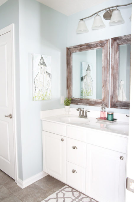 Master Bathroom with White Vanity and Wood Framed Mirrors, Sherwin Williams Rainwashed Paint Color