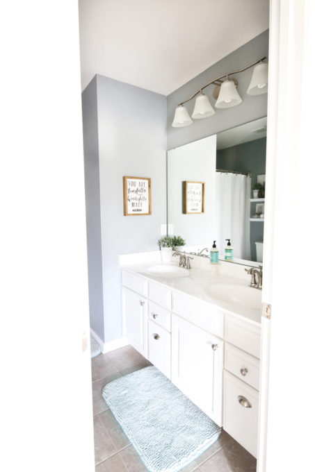 Guest Bathroom with White Vanity and Aqua Bath Mat