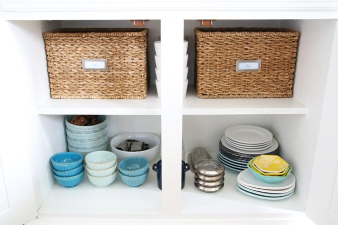 Organized Cabinets with Plates, Bowls and Baskets in the Dining Room