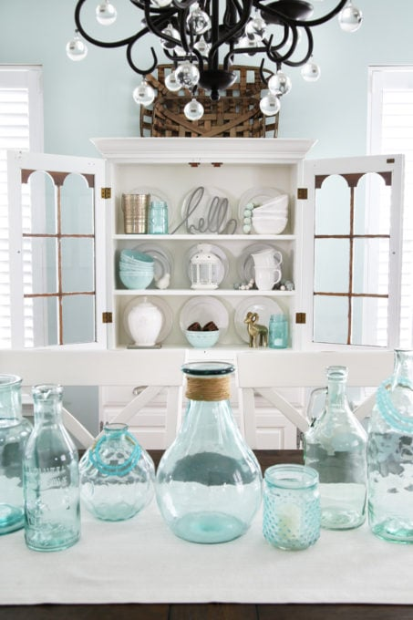 Coastal Dining Room with White China Cabinet Hutch and Aqua Glass Jars