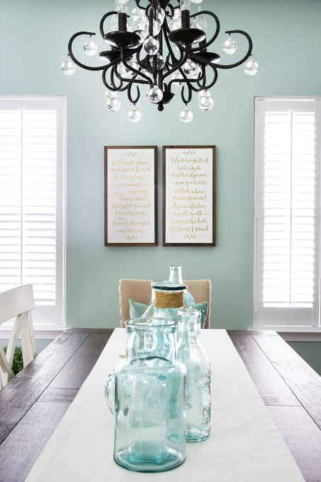 Dining Room Table with Aqua Glass Jars for a Centerpiece