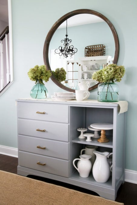 Gray Dining Room Sideboard with Round Wooden Mirror