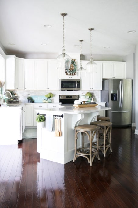 White Kitchen with Large Island and Corbels