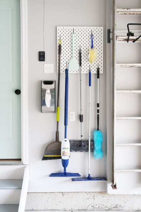 Brooms and Mops Stored on an IKEA SKADIS Pegboard in an Organized Garage