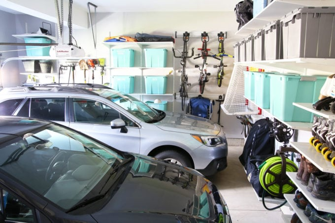 Organized Garage with Two Cars Parked Inside