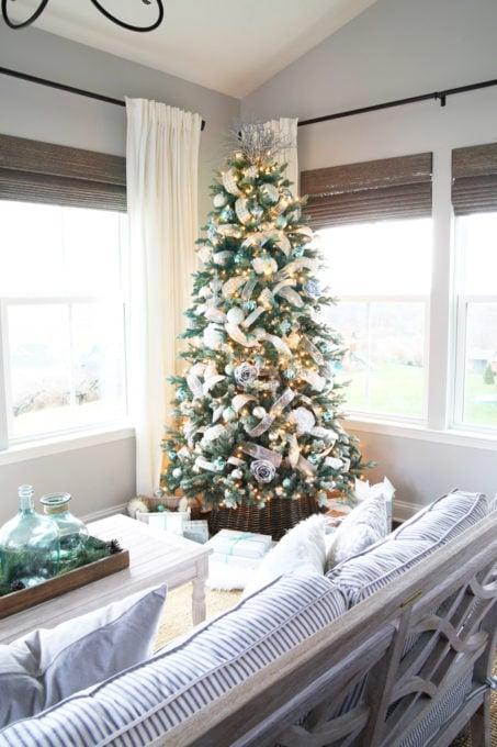 Ryan Homes Palermo Sunroom with a Christmas Tree and Holiday Decor