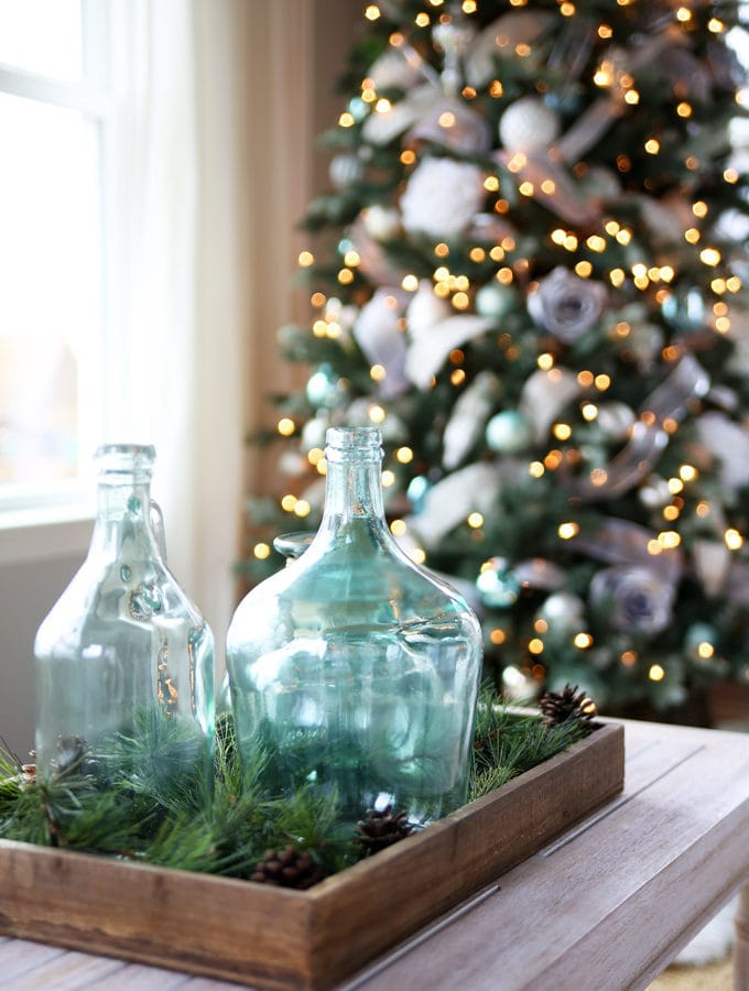 Aqua Demijohns in a Sunroom Decorated for Christmas