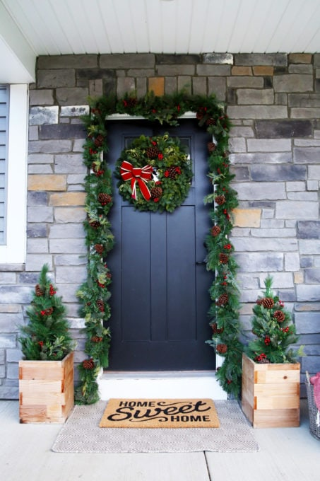 Front Door Decorated for Christmas with a Fresh Wreath