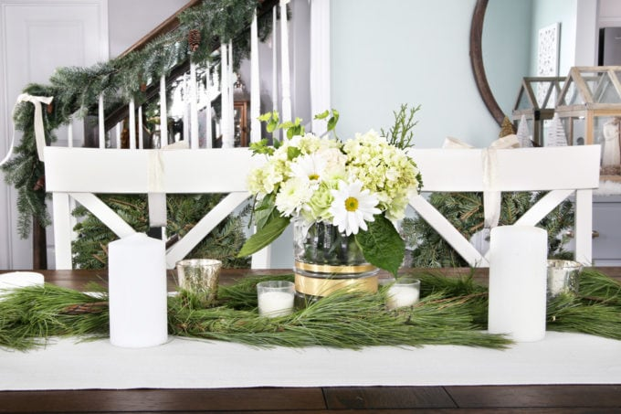 Neutral Christmas Dining Room Centerpiece with Fresh Greens