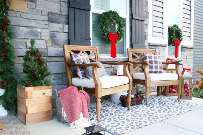 Christmas Porch with Wooden Chairs and Plaid Pillows