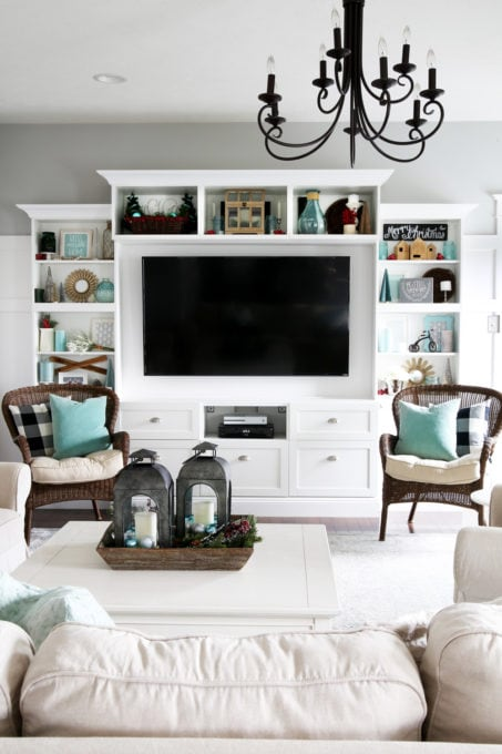 Living Room Shelves with Aqua and White Christmas Decor