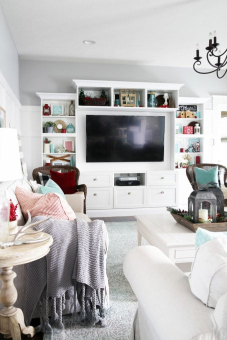Living Room Shelves Styled with Red and Aqua Christmas Decor
