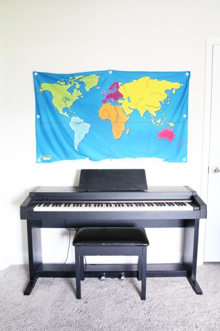 Keyboard and Wall Map in Organized Playroom