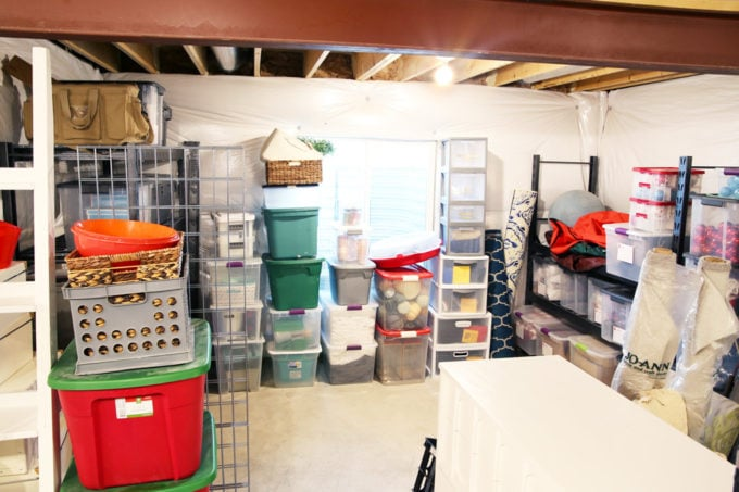 Basement Storage Nook with Storage Bins and Tubs