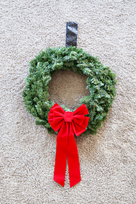 Christmas Wreath with Ribbon and Bow to Hang on Exterior Window