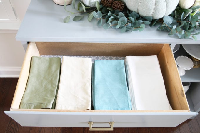 Organized Napkins in a Dining Room Sideboard Buffet