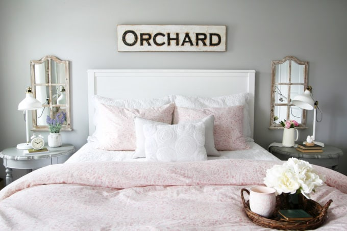 Bed with White Shiplap Headboard and Pink Paisley Duvet Cover